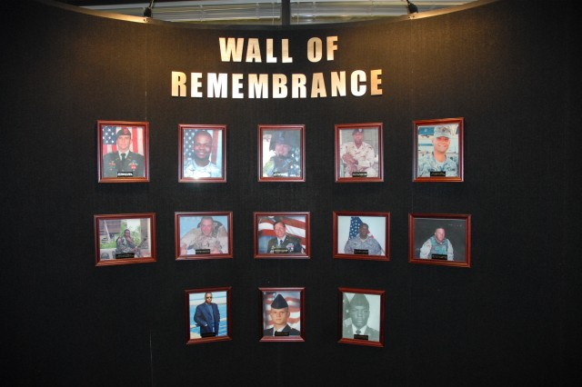 """A """"Wall of Remembrance,"""" memorializing 13 of South Carolina's fallen Soldiers killed in action will remain on display indefinitely inside the front entrance of the Strom Thurmond Building."""