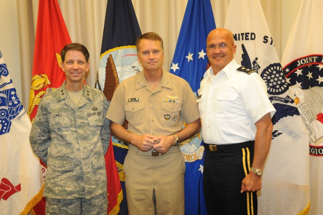 Left to right: Maj. Gen. Darrell Jones, commander, Air Force District of Washington, Admiral James A. Winnefeld, commander of U.S. Northern Command and Maj. Gen. Karl R. Horst, commander of Joint Force Headquarters-National Capital Region and The U.S. Army Military District of Washington pose for a photo during Admiral Winnefeld's  visit to Ft. McNair.