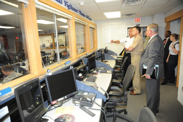 Maj. Gen. Karl R. Horst, commander of Joint Force Headquarters-National Capital Region and The U.S. Army Military District of Washington shows Admiral James A. Winnefeld, commander of U.S. Northern Command the Joint Operations Center.