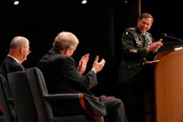 U.S. Central Command Commander Gen. David Petraeus thanks Rep. Ike Skelton for his welcome, and Sen. Kit Bond applauds, as Petraeus prepares to deliver his address at the Korean War Veterans Appreciation ceremony June 21 at the Community of Christ Auditorium in Independence, Mo. Petraeus was named June 23 to replace Gen. Stanley McChrystal as head of U.S. Command in Afghanistan.
