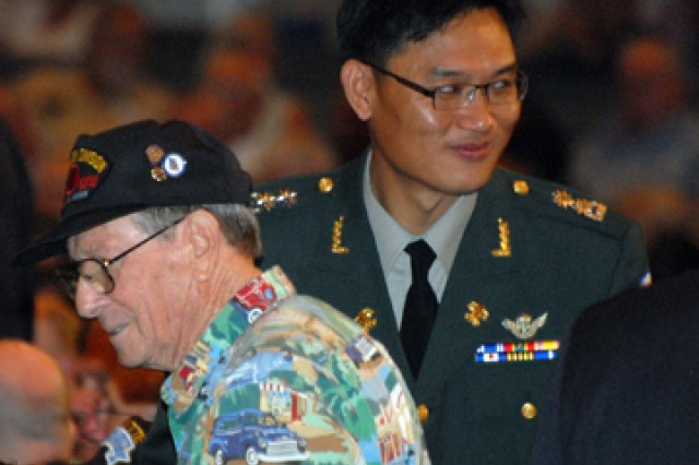 Korean Liaison Officer Lt. Col. Yoonkap Lim finds his seat among Korean War veterans and other Fort Leavenworth attendees before the Korean War Veterans Appreciation ceremony June 21 at the Community of Christ Auditorium in Independence, Mo.