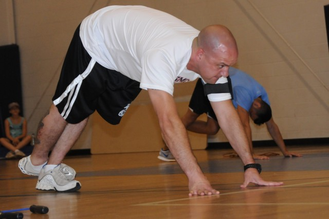 George Roberts stretches before taking part in the jump rope portion of the Cardio Challenge at Fortenberry-Colton Physical Fitness Facility June 16. Roberts participated in all three events, including cardio strength interval and Zumba.
