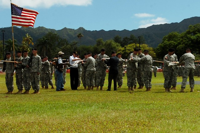Col. Malcolm B. Frost (far left,) commander, 2nd Brigade Combat Team, 25th Infantry Division, and his battalion commanders case the units' colors during their deployment ceremony June 24 at Sills Field, Schofield Barracks, Hawaii. The brigade will deploy as an Advise and Assist Brigade in support of Operation Iraqi Freedom in Northern Iraq, where it will be at the forefront of training and empowering the Iraqi Security Forces.  (U.S. Army photo by Spc. Mahlet Tesfaye, 25th Infantry Division Public Affairs Office.)