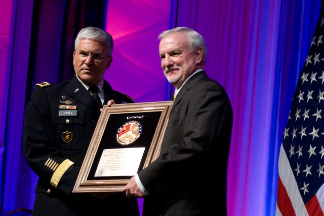 Chief of Staff of the Army, Gen. George W. Casey Jr., presents a Combined Logistics Excellence Award in Richmond, Va., June 24, 2010.