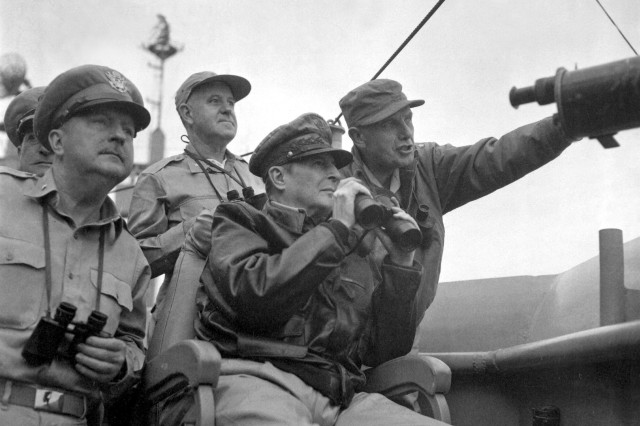 Brig. Gen. Courtney Whitney; Gen. Douglas MacArthur, Commander in Chief of U.N. Forces; and Maj. Gen. Edward M. Almond observe the shelling of Inchon from the USS Mt. McKinley, Sept. 15, 1950.