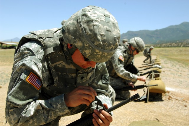 Spc. Cesar Cobena, 5th Signal Command, competes for the Noncommissioned Officer and Soldier of the Year competition at the M16 qualifying range, June 14.