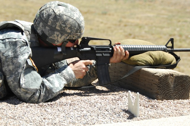 Spc. Dustin Higgins, 311th  Signal Command, competes  at the M16 qualifying range during the U.S. Army Network Enterprise Technology Command/9th Signal Command (Army) Noncommissioned Officer and Soldier of the Year competition at Fort Huachuca, June 14.