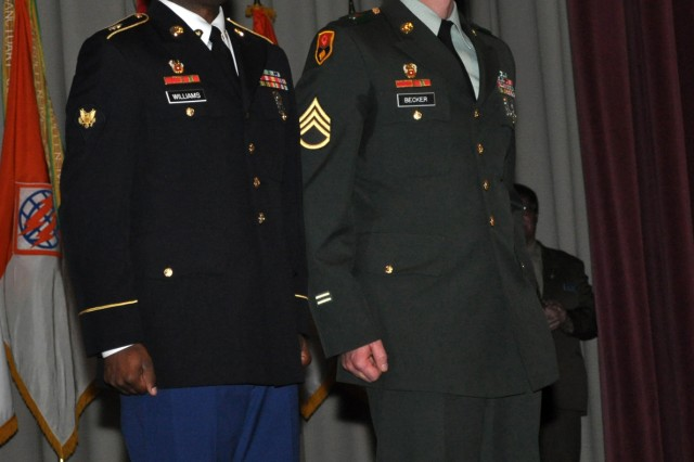 The 2010 9th Signal Command (Army) Soldier of the Year Spc. Brian Williams (left), 21st Signal Brigade, Fort Detrick, Md., and the Noncommissioned Officer of the Year, Staff Sgt. James Becker, 1st Signal Brigade, Camp Carroll, Korea, are recognized during a ceremony Friday in the command headquarters' auditorium.