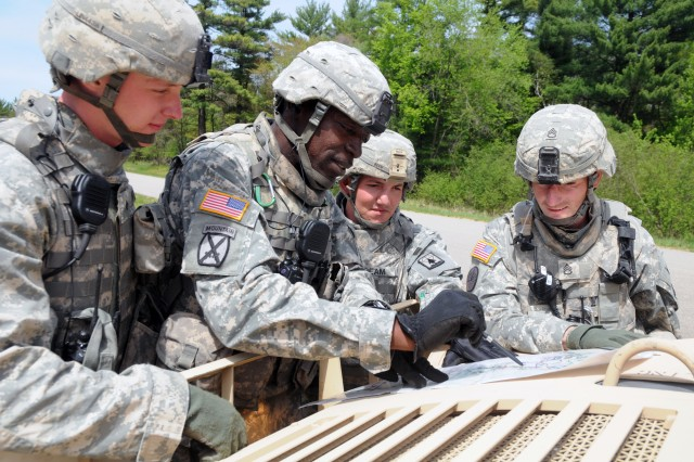 Four observer controller trainers from the 3rd, 340th Training Support Battalion, 181st Infantry Brigade, check a Fort McCoy map to determine the next route they will direct the 806th Engineer Company to during mobilization training. From left are Sgt. Jeremiah Lindquist, Sgt. 1st Class Rob Merriweather, Sgt. Chuck Beam, and Staff Sgt. Jeremiah Johnson.