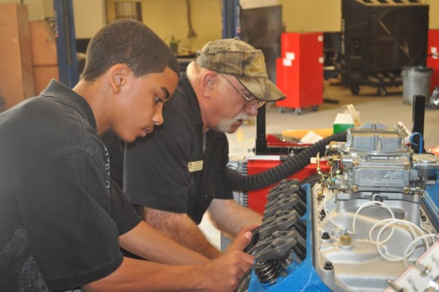 Edge student Jeffery Freeman and teacher Bill Woosley work together to complete the engine.