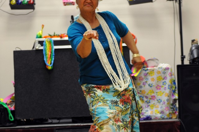 PRESIDIO OF MONTEREY, Calif. - Toeme Silva demonstrates her Hawaiian-style dance skills to the attendees of the BOSS luau at the Hobson Student Activity Center June 18.