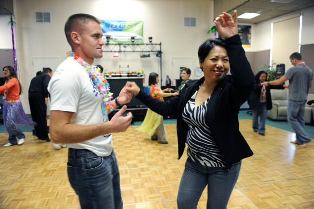 PRESIDIO OF MONTEREY, Calif. - Partygoers learned the basics of ballroom dance during the BOSS luau at the Hobson Student Activity Center June 18.