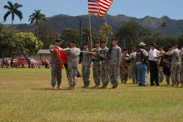Col. Malcolm B. Frost (front left,) commander, 2nd Brigade Combat Team, 25th Infantry Division, and his battalion commanders case the units' colors during their deployment ceremony June 24 at Sills Field, Schofield Barracks, Hawaii. The brigade will deploy as an Advise and Assist Brigade in support of Operation Iraqi Freedom in Northern Iraq, where it will be at the forefront of training and empowering the Iraqi Security Forces. (U.S. Army photo by Spc. Mahlet Tesfaye, 25th Infantry Division Public Affairs Office)