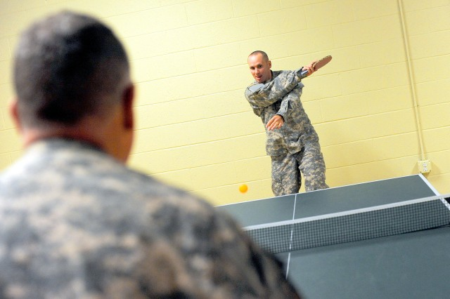Sgt. Jamie Jones, right, returns a ball to Staff Sgt. Russel Ahner during a ping-pong match at the JBLM Nelson Recreation Center. The facility recently reopened after a $4.5 million renovation.