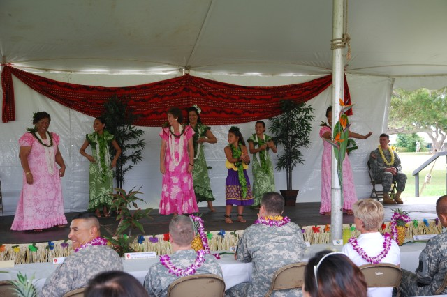 Schofield Barracks, Hawaii - The 500th Military Intelligence Brigade, Army EO, and USAG-HI hosted a May Day celebration here on May 14th. The celebration included hula performances, a martial arts demonstration, a Chinese dance and dragon show, a Hawaiian cowboy parade on horses, Hawaiian music and Asian-Pacific ethnic food booths.