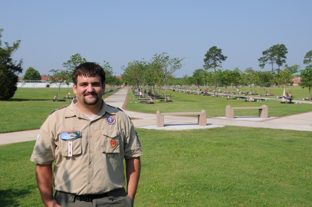 Aaron Jacobs, an Eagle Scout with Troop 410 in Hinesville, stands in front  of two of the five benches he and his troop put in at Warriors Walk as his Eagle Scout project. Jacobs, the son of a retired Soldier, led the project which took more than 300 hours or planning and labor to complete. The benches were put in place June 15.