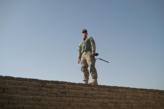Staff Sgt. Clint Wilson of Jerusalem, Ark., a platoon sergeant with Headquarters and Headquarters Battery, 3rd Battalion, 29th Field Artillery Regiment, 3rd Brigade Combat Team, 4th Infantry Division, stands on top a wall during the guided tour of the Ziggurat of Ur June 5.