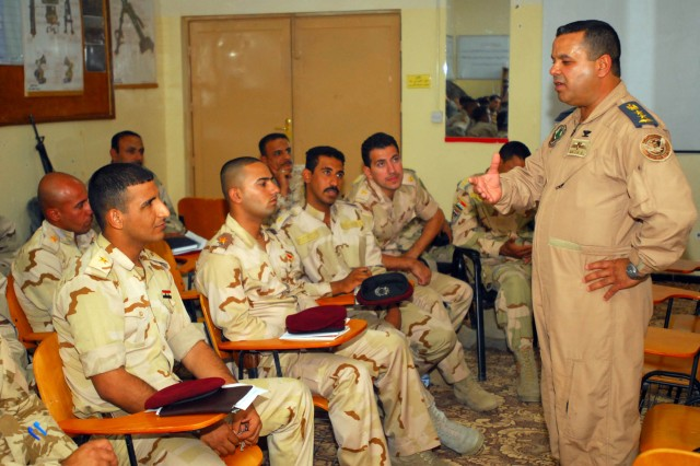 Col. Nazih al-Fahaed, commander of the 70th Squadron Iraqi Air Force, explains to soldiers with the 10th Iraqi Army Division how Iraqi Securty Forces can benefit from a mutual relationship and cooperation in spirit of maintaining the security and protection of the Iraqi people June 3 at Contingency Operating Station GarryOwen, Iraq.