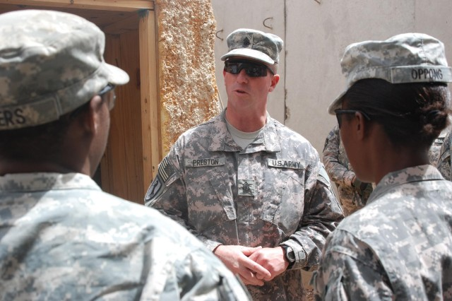 Sgt. Maj. of the Army Kenneth Preston, senior enlisted member of the U.S. Army, talks to Soldiers of the 4th Squadron, 10th Cavalry Regiment at Patrol Base Minden in southern Iraq June 25. Preston is a former member of the 10th Cav. Regt.