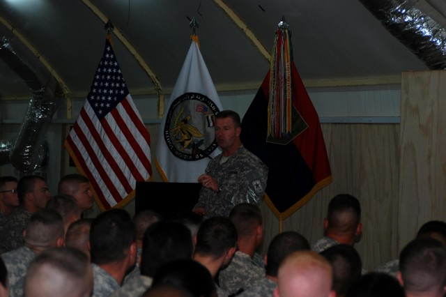 Sgt. Maj. of the Army Kenneth Preston, senior enlisted member of the U.S. Army, addresses United States Division-South Soldiers at the Contingency Operating Base Basra Town Hall June 25. Preston fielded questions on a variety of topics, from uniforms and uniform policies to dwell time.