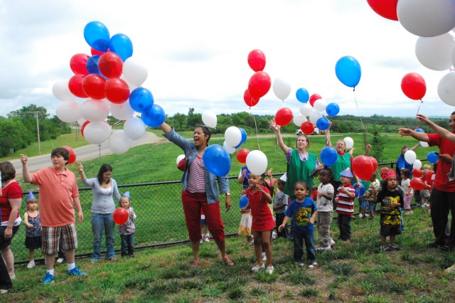 Carol Brooks, wife of Maj. Gen. Vincent K. Brooks, 1st Inf. Div. and Fort Riley commanding general, releases balloons with children from the 1st Inf. Div. CDC June 14 during an Army and 1st Inf. Div. birthday celebration.