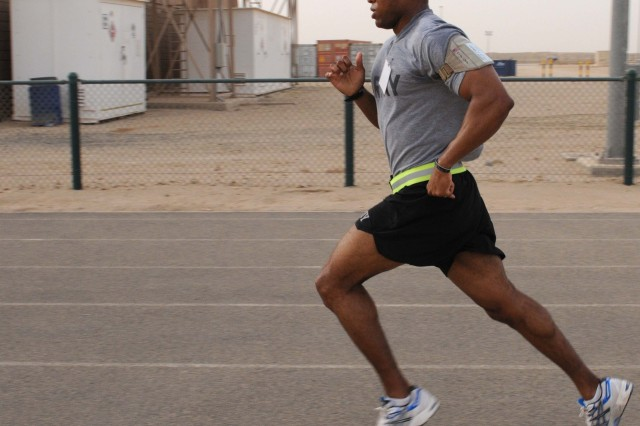 "CAMP ARIFJAN, Kuwait - Capt. Daniel S. Brown, Battle Captain of the 53rd Infantry Brigade Combat Team, brings home another first place victory in the ""Law Day 5k"" here, May 1.( )"