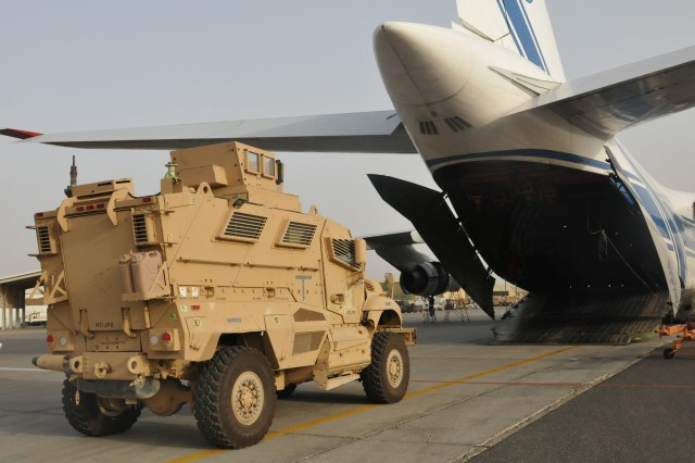 CAMP ARIFJAN, Kuwait -- Mine-Resistant Ambush Protected Maxx Pro vehicles are loaded onto a transport aircraft in support of the responsible drawdown of U.S. forces in Iraq.  The 62nd Chemical Company provides the security for the vehicles throughout the flight.