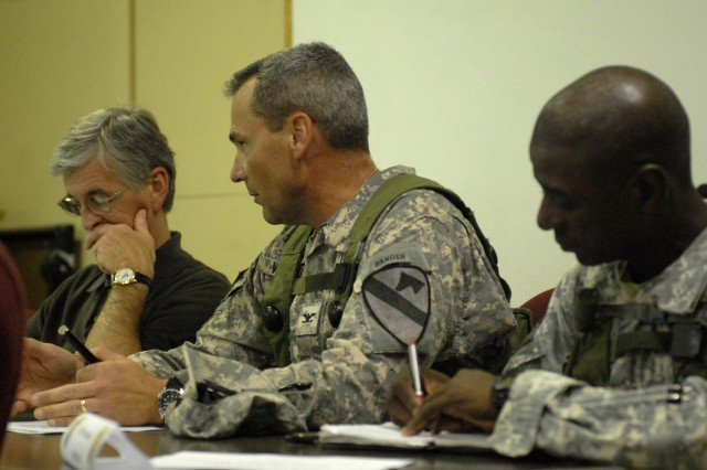 FORT POLK, La.- Col. Brian Winski (center), commander, 4th Brigade Combat Team, 1st Cavalry Division, speaks with Secretary of the Army, the Honorable John McHugh, about his brigade's training during their Joint Training Readiness Training Center rotation, June 23. The brigade is training for deployment to Iraq this fall.