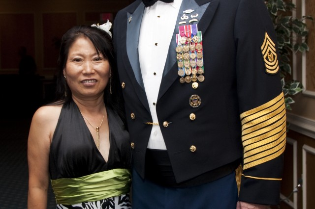 Cmd. Sgt. Maj. David M. Bruner, command sergeant major of U.S. Army Training and Doctrine Command, and his wife, Nam, pose for a photograph at the first TRADOC Ball on Langley Air Force Base, Va., June 26, 2010. (U.S. Army Sgt. Angelica Golindano) (RELEASED)