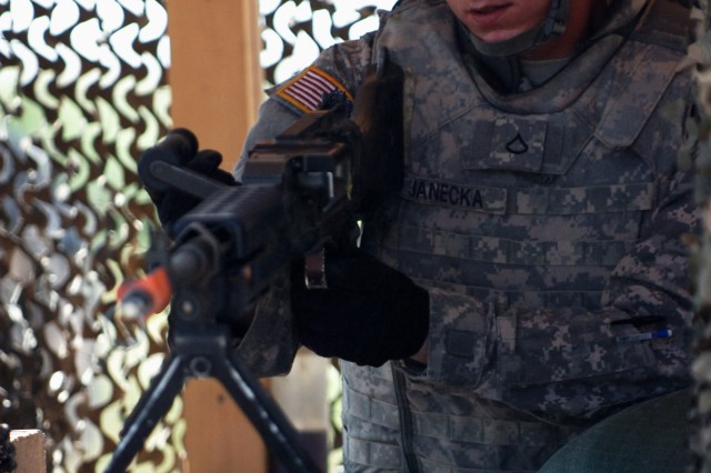 FORT HOOD, Texas - Pfc. Chase Janecka, of Austin, Texas, 2nd Battalion, 8th Cavalry Regiment, 1st Brigade Combat Team, 1st Cavalry Division, corrects a malfunction on an M240B machine gun, June 23, on the traffic control point lane during the 1st BCT Iron Warrior Stakes competition.