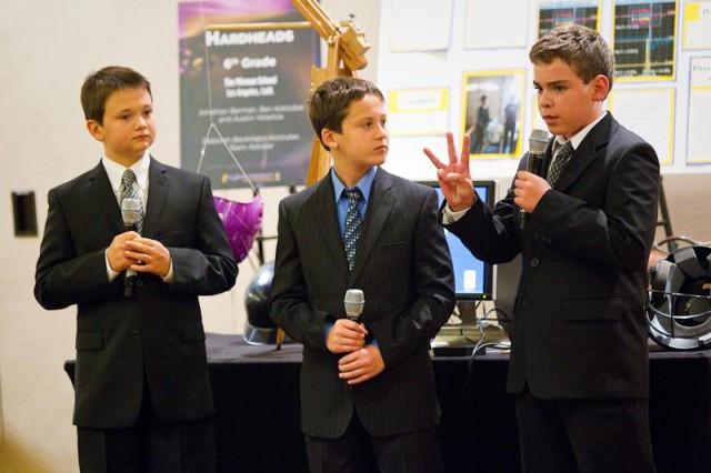 The eCYBERMISSION program winning sixth- grade team, The Hardheads -- Jonathan Berman, Benjamin Kotzubei, Austin Veseliza -- present their project during the national showcase June 24.