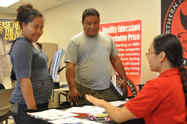 SAIPAN, Northern Mariana Islands--Marissa L. Takai, an admissions specialist at Northern Marianas College, explains NMI's application process to Relihna Iakopus, a recent graduate of Marianas High School, and her father, Pisan Peter, at the  U.S. Army Reserve Center, Saturday, during the U.S. Army Reserve Theater Support Group's first ever Education Fair in Saipan.