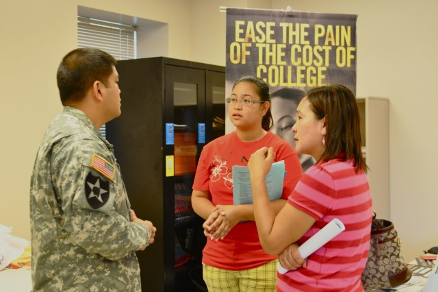 SAIPAN, Northern Mariana Islands--Alyssa Palattao (center) and her mother, Shirley Galvan, listen closely to Staff Sgt. Raymond Leonguerrero, a U.S. Army Recruiter, as he explains the process of joining the Army Reserve. Palattao is hoping to join either the Army Reserve or National Guard before continuing to pursue her education goals.