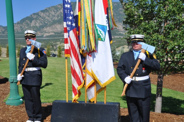 FORT CARSON, Colo.---Firemen stand guard at the flags during the World Trade Centers Memorial dedication ceremony June 19.