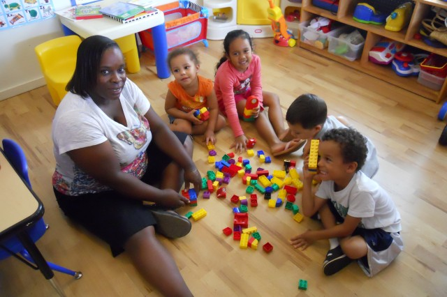 SCHOFIELD BARRACKS, Hawaii - Pam Murray, child care provider with the Family Child Care Program, here, interacts with children in her care during small group activities. From left to right are Pam Murray, Angel Slaton, Kaytyla Domingo, Aydin Buchanan and William Slaton.