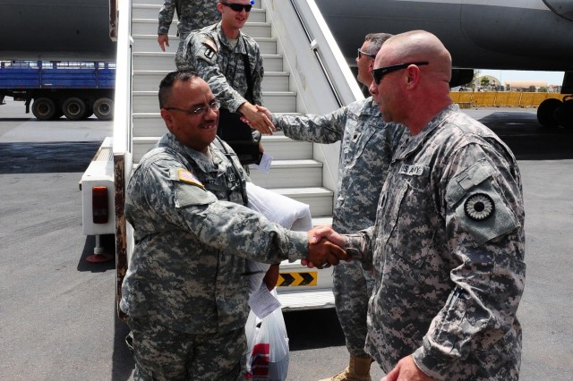 CAMP LEMONNIER, Djibouti - Command Sgt. Maj. Troy Hester, and Lt. Col. Greg Mittman, the 2/137th battalion commander, greet newly arriving Soldiers of the Kansas Army National Guard 2/137th Combined Arms Battalion (CAB) at Djibouti International Airport, June 18, 2010. The 2/137th CAB is replacing the 1/65th Puerto Rico Army National Guard, serving under Combined Joint Task Force - Horn of Africa.