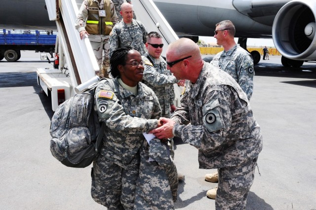 CAMP LEMONNIER, Djibouti - Command Sgt. Maj. Troy Hester, Kansas Army National Guard 2/137th Combined Arms Battalion (CAB), greets newly arriving Soldiers of the 2/137th CAB at Djibouti International Airport, June 18, 2010. The 2/137th CAB is replacing the 1/65th Puerto Rico Army National Guard, serving under Combined Joint Task Force - Horn of Africa.