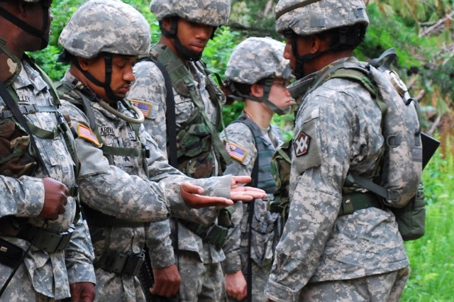 FORT GEORGE G. MEADE, Md. - Army Staff Sgt. Michael Griffis (right) examines Sgt. Kareem Abdul Aziz's hands as part of formation procedures before the Soldiers begin the day's events. Griffis and Abdul Aziz, both of Baltimore, are members of the 611th Quartermaster Company and are among the Soldiers competing in the Philip A. Connelly competition here, June 26. The 611th QM Co. is a Reserve unit out of Baltimore competing against 12 other teams to become one of the top four food service units in the U.S. Army Reserve Command competition. (U.S. Army photo by Spc. Sophia Lopez, 316th ESC Public Affairs Office)