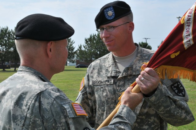 FORT STORY, Va - Lieutenant Col. John M. Broomhead, commander 11th Transportation Battalion (right) receives the colors from Col. Charles F. Maskell, commander, 7th Sustainment Brigade during the 11th Transportation Battalion 'Over the Shore' change of command ceremony conducted at Joint Base Expeditionary Little Creek - Fort Story the morning of June 25. (U.S. Army photo Sgt. 1st Class Kelly Jo Bridgwater)