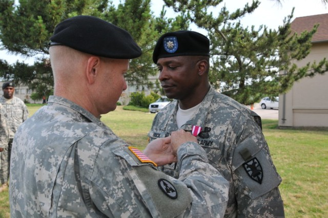 FORT STORY, Va - Colonel Charles F. Maskell, (left) commander, 7th Sustainment Brigade, pins the Meritorious Service Medal onto the collar of Lt. Col. Robert L. Irick, outgoing commander, 11th Transportation Battalion prior to the start of the battalion's change of command ceremony the morning of June 25 at Joint Base Expeditionary Little Creek - Fort Story. (U.S. Army photo Sgt. 1st Class Kelly Jo Bridgwater)