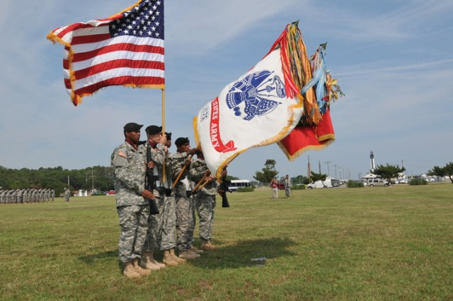 FORT STORY, Va - 'Over the Shore' color guard Soldiers stand tall in the morning sun June 25 during the 11th Transportation Battalion's change of command ceremony held at Joint Base Expeditionary Little Creek - Fort Story. (U.S. Army photo Sgt. 1st Class Kelly Jo Bridgwater)