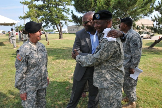 """FORT STORY, Va - Brigadier Gen. Robin B. Akin, (left) commanding general, 3rd Sustainment Command (Expeditionary), Fort Knox, Ky. prepares to congratulate outgoing 'Over the Shore' commander, 11th Transportation Battalion, 7th Sustainment Brigade, Lt. Col. Robert L. Irick (right) upon receipt of the Meritorious Service Medal June 25 at Joint Base Expeditionary Little Creek - Fort Story. (U.S. Army photo Sgt. 1st Class Kelly Jo Bridgwater)"""""""