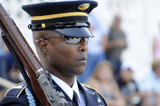 Sgt. 1st Class Alfred Lanier, Sergeant of the Guard, Tomb of the Unknown Soldier, stands for 21 seconds during his final walk on June 25. The number, 21, symbolizes the highest military honor that can be bestowed, the 21-gun salute.