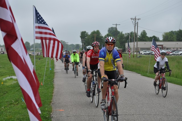 Riders begin cycling away from the starting line at the Crane CycleFest Ride 2 Recovery event May 22 to benefit disabled and wounded Warriors.