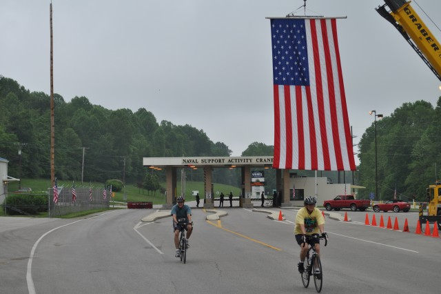 Riders cycle away from the NSA Crane gate during the Crane CycleFest Ride 2 Recovery event May 22 to benefit disabled and wounded Warriors.