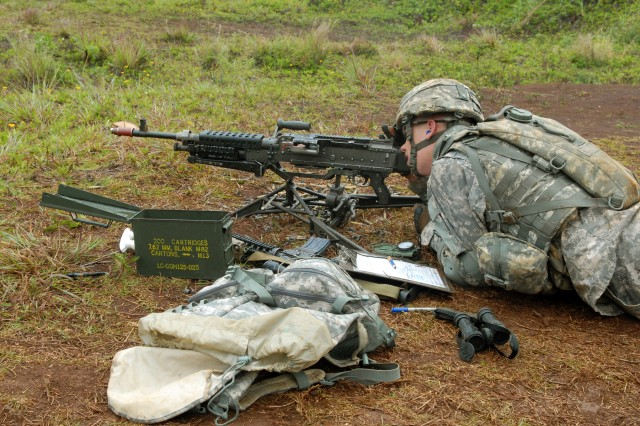 Spc. Jason Jennings, an infantryman with Co. C, 2nd Battalion, 35th Infantry Regiment, 3rd Brigade Combat Team, 25th Infantry Division, looks into an M-249 Squad Automatic Weapon to complete his range card during the 3rd Bde. Combat Team EIB training and testing at Schofield Barracks, Hawaii, June 20-25.