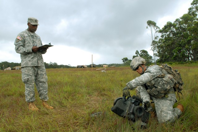 Staff Sgt. Lou Brown, an infantryman with Headquarters and Headquarters Co., 2nd Battalion, 35th Infantry Regiment, 3rd Brigade Combat Team, 25th Infantry Division, prepares to pick up and fire a military weapon called a Javelin during one of the three lanes of the 3rd Bde. Combat Team EIB training and testing course held at East Range, Schofield Barracks, Hawaii, June 20-25.