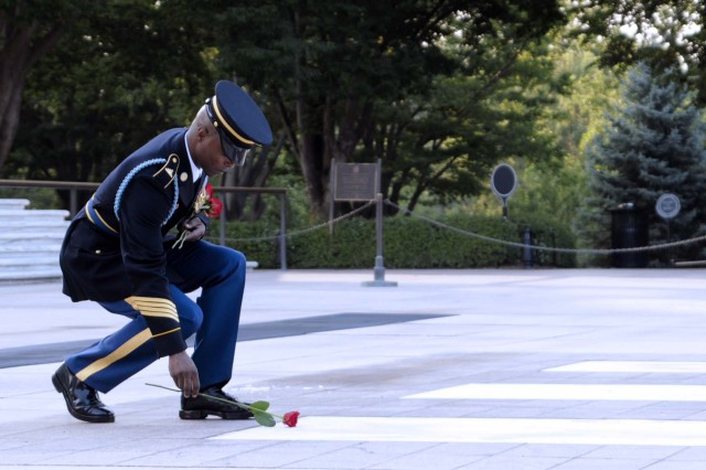 Sgt. 1st Class Alfred Lanier, Sergeant of the Guard, Tomb of the Unknown Soldier, lays a rose at the Tomb in remembrance of his final walk on June 25. Sentinels lay roses signifying leaving the Tomb, and the love they have for the job and the Unknowns.