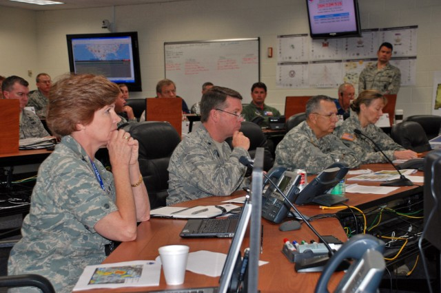 From left to right, Col. Connie McNabb, chief of the Texas Joint Staff, Air Force Brig. Gen. John Nichols, commander of the Texas Air National Guard, Maj. Gen. Jose Mayorga, the adjutant general of the Texas National Guard, Army Brig. Gen. Joyce Stevens, commander of the Texas Army National Guard, listen intently to the National Weather Bureau predictions for Tropical Storm Alex in the Joint Emergency Operations Center at Camp Mabry June 29, 2010.