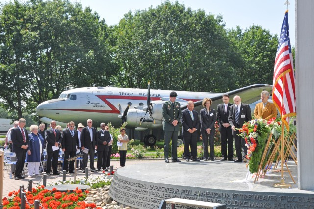 German and American military and civilian officials pay tribute to those who sacrificed their lives on the 62nd anniversary of the Berlin Airlift at a memorial at the Frankfurt International Airport.